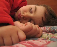 a_child_sleeping_by_wikimediacommons